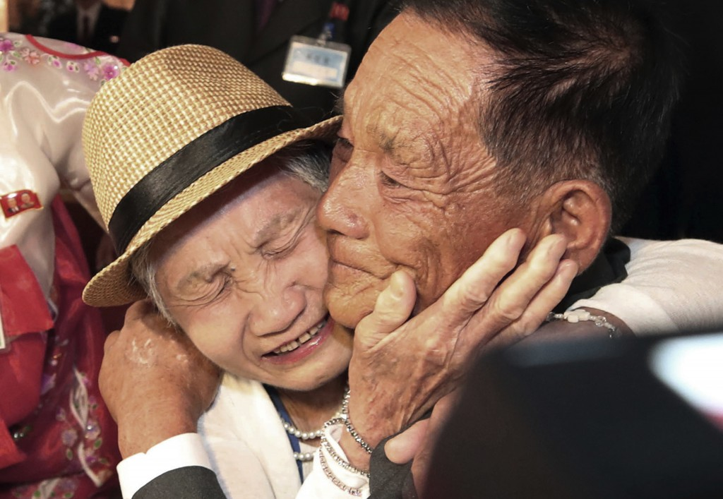 South Korean Lee Keum-seom, 92, weeps with her North Korean son, Ri Sang Chol, 71, during the Separated Family Reunion Meeting at the Diamond Mountain...