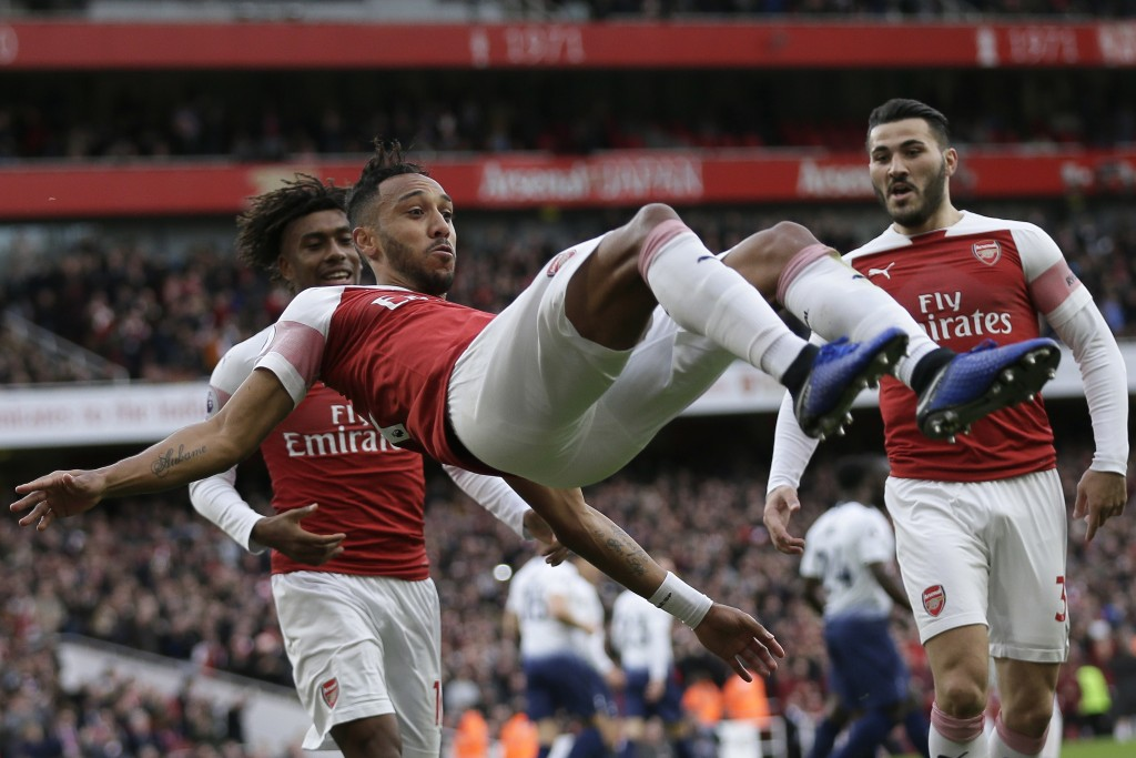 Arsenal's Pierre-Emerick Aubameyang celebrates with his teammates after scoring his side's opening goal from the penalty spot during the English Premi