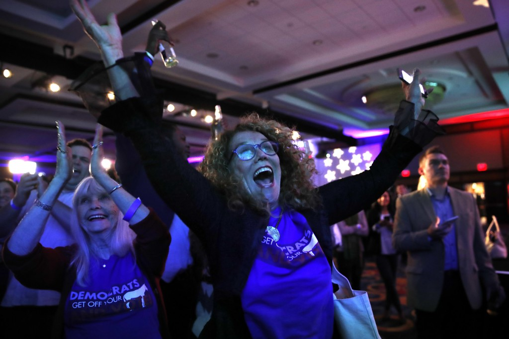Sydney Crawford, 84, left, of New York, and JoAnn Loulan, 70, of Portola Valley, Calif., cheer as election returns come in during a Democratic party e
