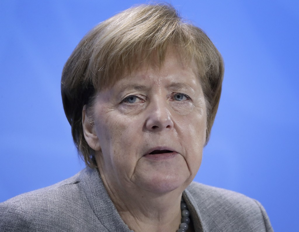 German Chancellor Angela Merkel addresses the media during a press conference at the chancellery in Berlin, Germany, Monday, Dec. 3, 2018 after a meet...