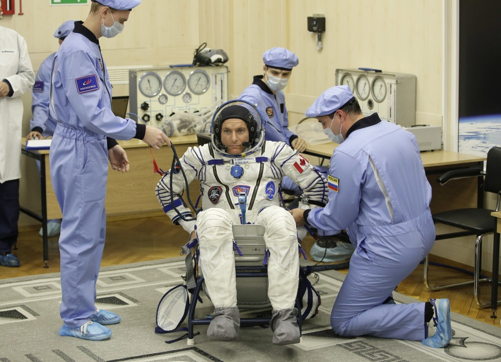 Russian Space Agency experts help CSA astronaut David Saint Jacques, member of the main crew of the expedition to the International Space Station (ISS