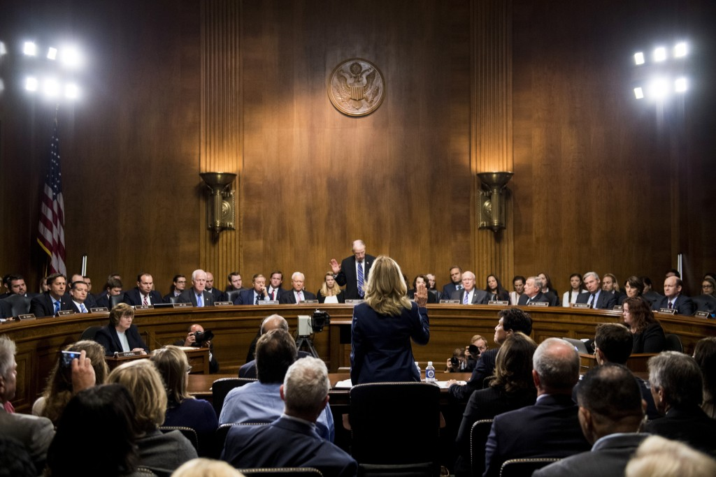 Christine Blasey Ford is sworn in by Senate Judiciary Committee chairman Chuck Grassley, R-Iowa, at the start of her testimony on Capitol Hill in Wash...