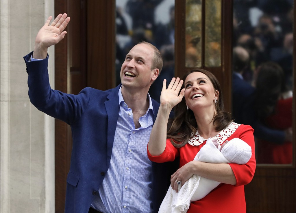 Britain's Prince William and Kate, Duchess of Cambridge, wave as she holds their newborn son outside St. Mary's Hospital in London on April 23, 2018. ...