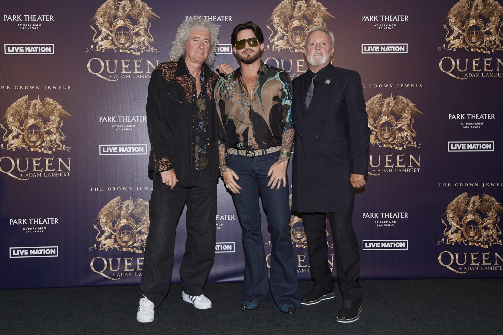 "FILE - In this Aug. 28, 2018, file photo, Brian May, from left, Adam Lambert, and Roger Taylor of Queen + Adam Lambert pose for a photo at the ""The Cr"
