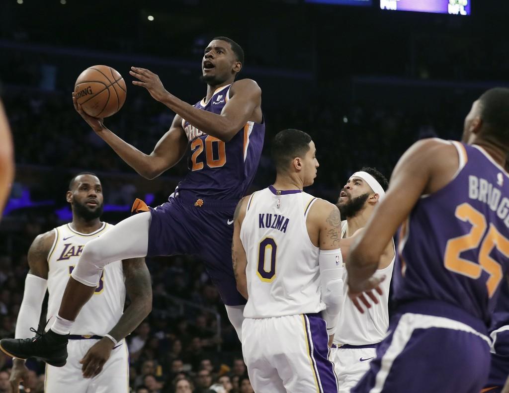Phoenix Suns' Josh Jackson (20) shoots past Los Angeles Lakers' Kyle Kuzma (0) during the first half of an NBA basketball game Sunday, Dec. 2, 2018, i