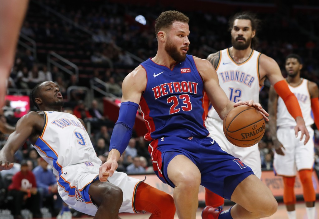 Detroit Pistons forward Blake Griffin (23) fouls Oklahoma City Thunder forward Jerami Grant (9) during the first half of an NBA basketball game, Monda