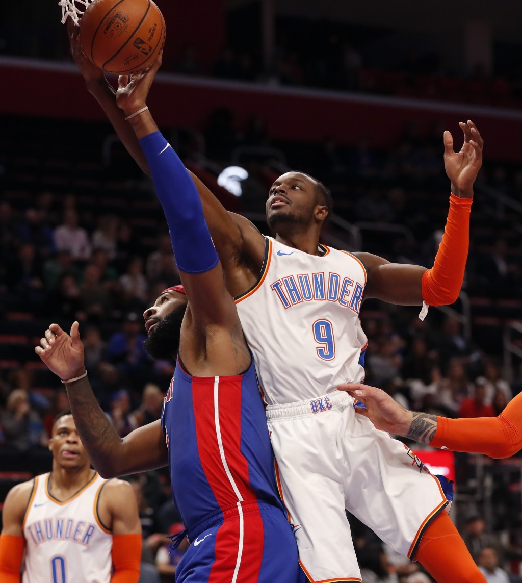 Oklahoma City Thunder forward Jerami Grant (9) reaches for the rebound next to Detroit Pistons center Andre Drummond during the first half of an NBA b