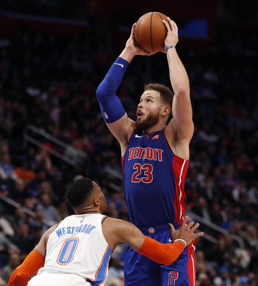 Detroit Pistons forward Blake Griffin (23) shoots as Oklahoma City Thunder guard Russell Westbrook (0) defends during the first half of an NBA basketb