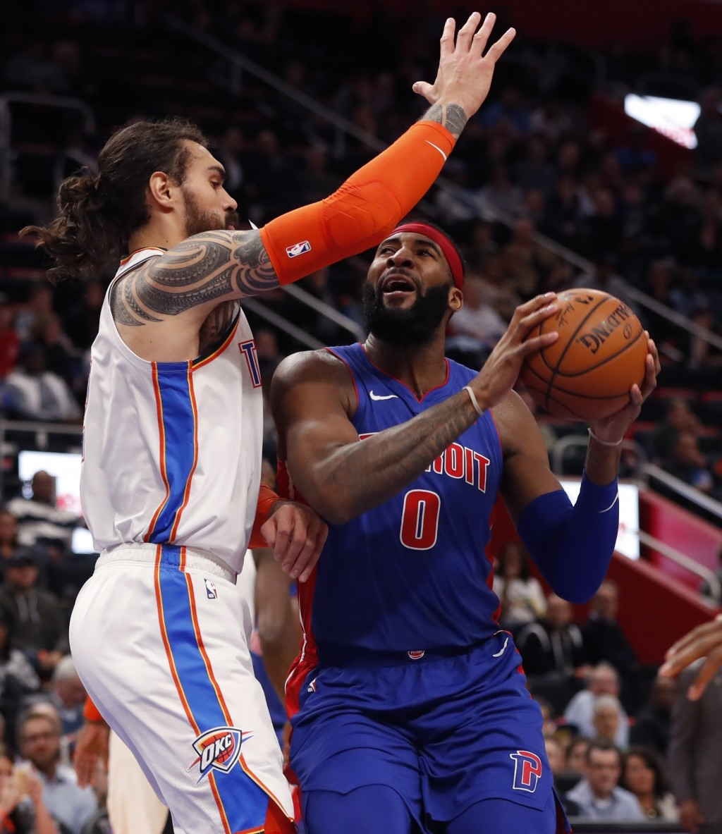 Detroit Pistons center Andre Drummond (0) is defended by Oklahoma City Thunder center Steven Adams during the first half of an NBA basketball game, Mo