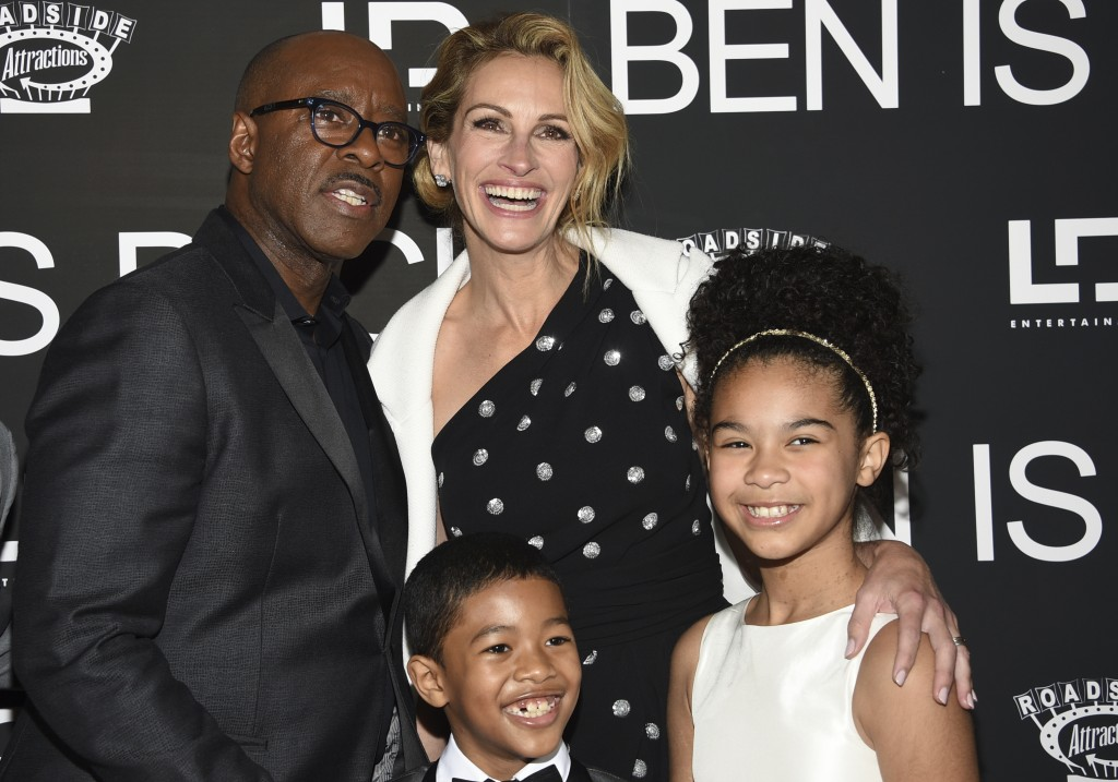 "Courtney B. Vance, from back row left, Julia Roberts, and from front row left, Jakari Fraser and Mia Fowler attend the premiere of ""Ben Is Back"" at AM"