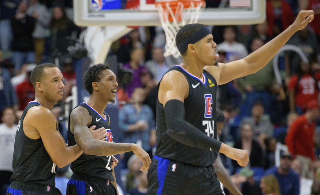 Los Angeles Clippers guard Lou Williams (23) is congratulated by guard Avery Bradley (11) as forward Tobias Harris (34) celebrates the two point baske...