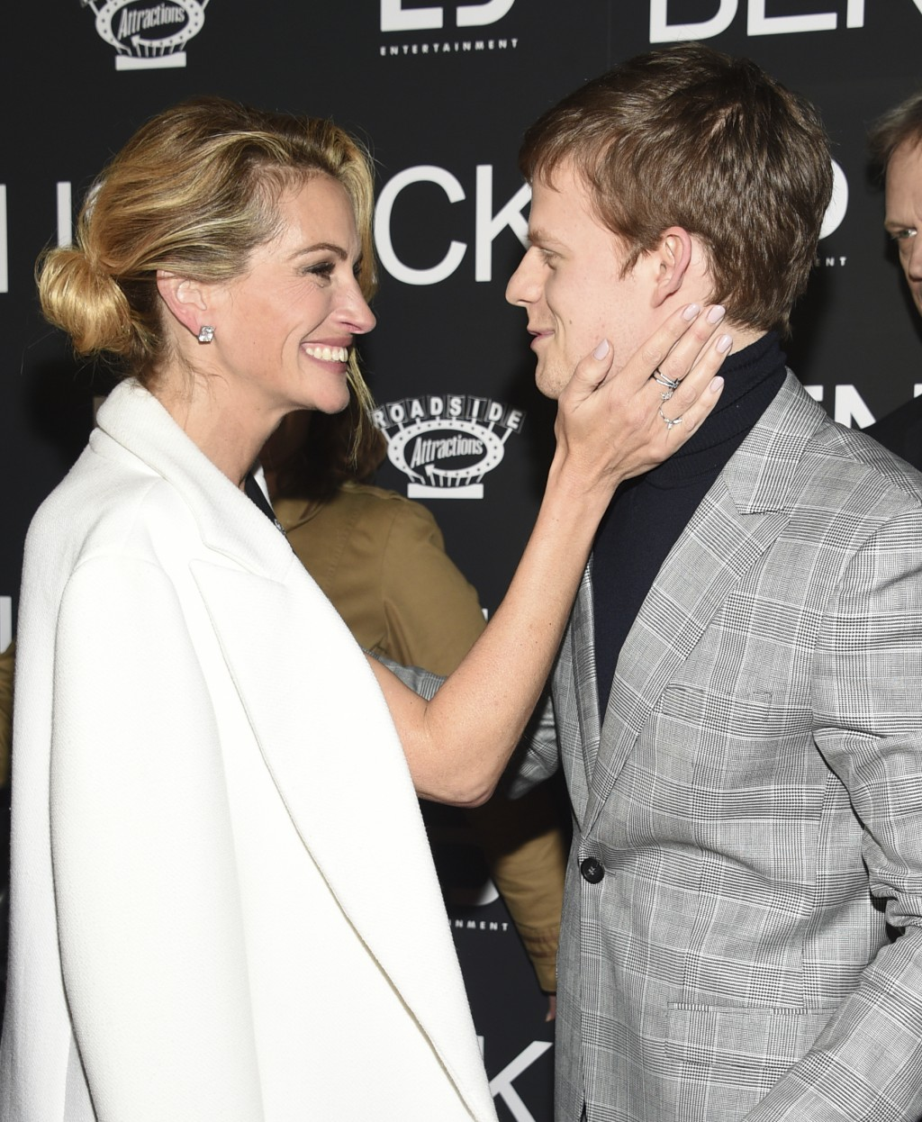 "Julia Roberts, left, greets Lucas Hedges as they attend the premiere of ""Ben Is Back"" at AMC Loews Lincoln Square on Monday, Dec. 3, 2018, in New York..."