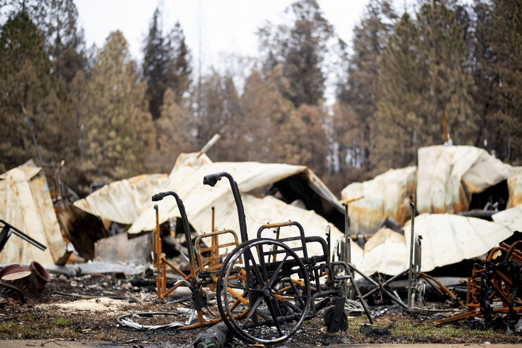 Scorched wheelchairs rest outside Cypress Meadows Post-Acute, a nursing home leveled by the Camp Fire, on Tuesday, Dec. 4, 2018, in Paradise, Calif. (