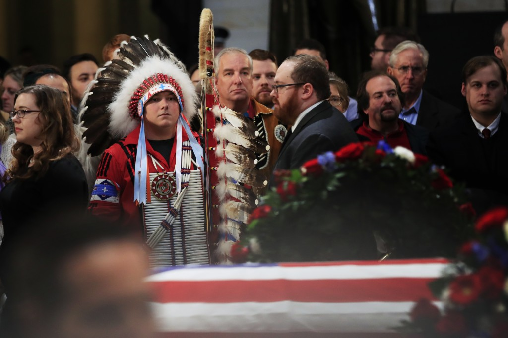 Native Americans Donald Woody, left, and Warren Stade of the Shakopee Mdewakanton Sioux Community tribe in Prior Lake, Minn., pay their last respects