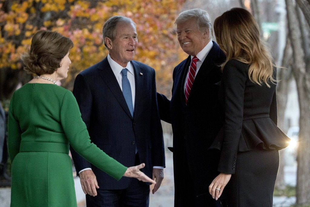 President Donald Trump and first lady Melania Trump are greeted by former President George Bush and former first lady Laura Bush outside the Blair Hou