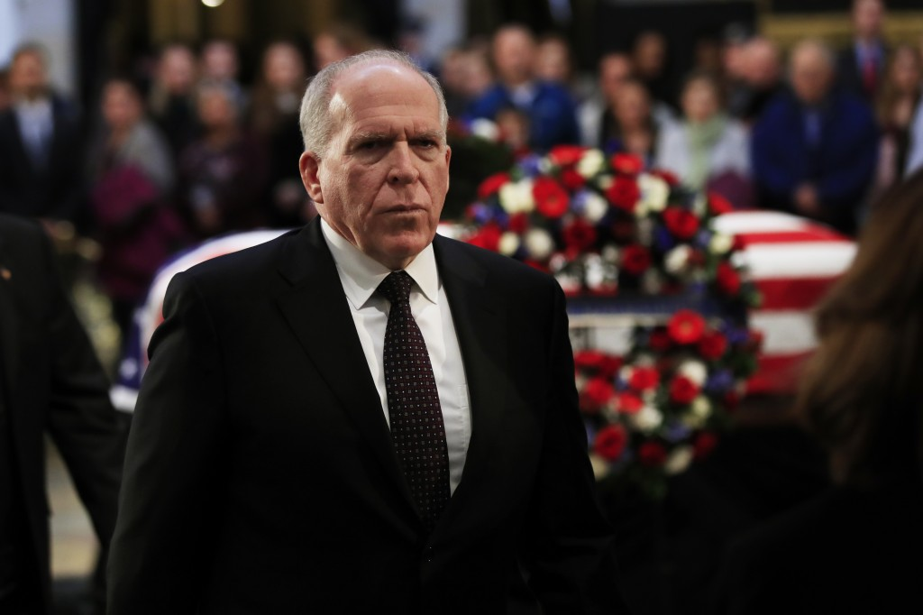 Former CIA Director John Brennan, leaves the Capitol Rotunda after paying his last respects to former President George H.W. Bush as he lies in state a