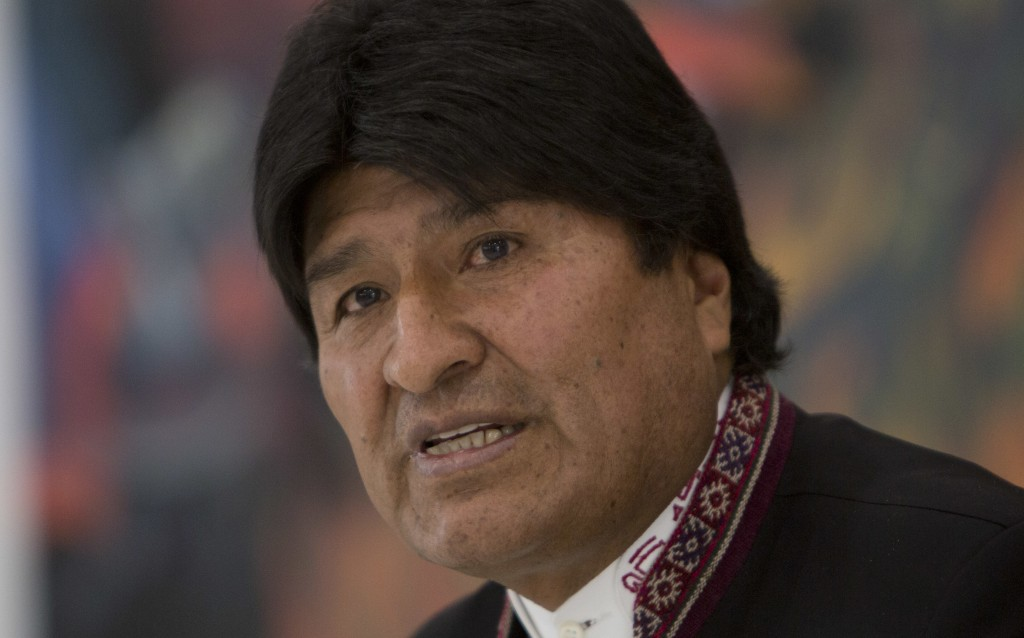 FILE - In this Oct. 2, 2018 file photo, Bolivia's President Evo Morales speaks during a press conference in Government Palace in La Paz, Bolivia.  Bol
