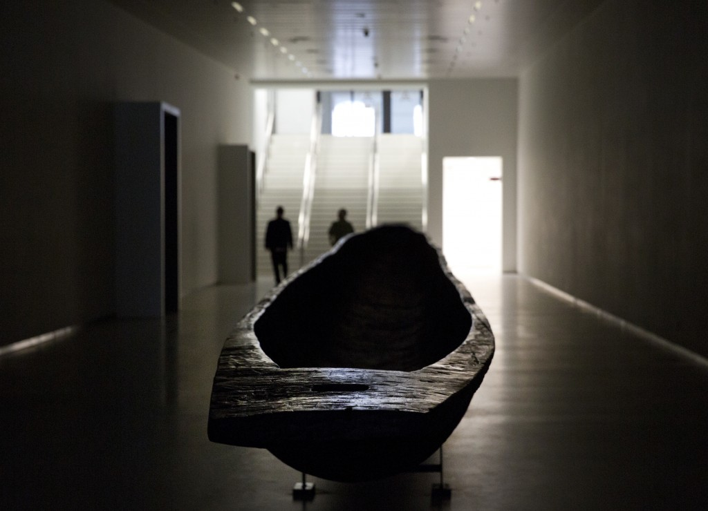 A wooden canoe, carved out of one piece of wood, in the main underground hallway leading to the Africa Museum in Tervuren, Belgium, Friday, Aug. 3, 20