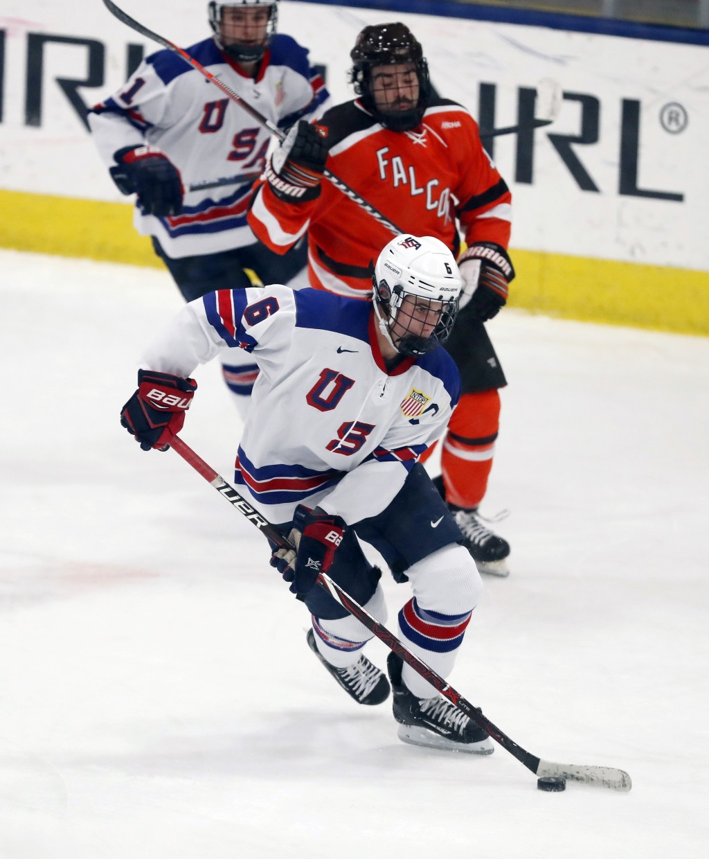In this Wednesday, Nov. 21, 2018, photo, Jack Hughes, foreground, expected to be a top pick in the next NHL hockey draft, plays against Bowling Green ...