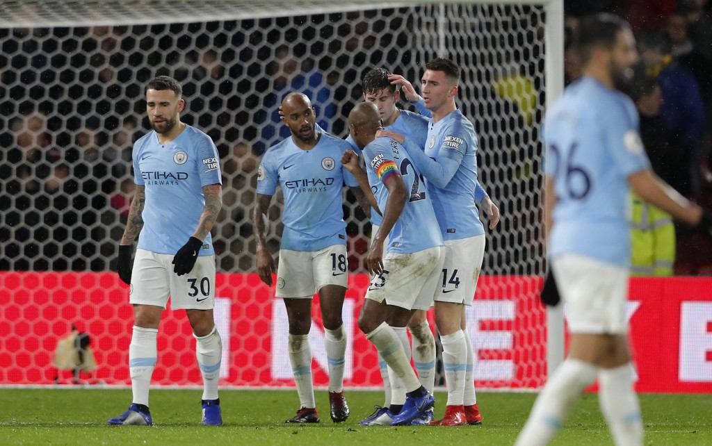 Manchester City players celebrate after winning the English Premier League soccer match between Watford and Manchester City at Vicarage Road stadium i