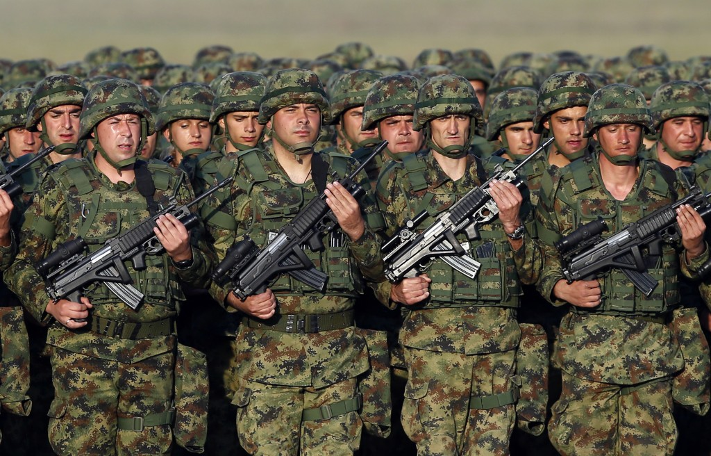 In this photo taken on Tuesday, Oct. 17, 2017, Serbian Army soldiers perform during rehearsal exercise in Batajnica, military airport near Belgrade, S