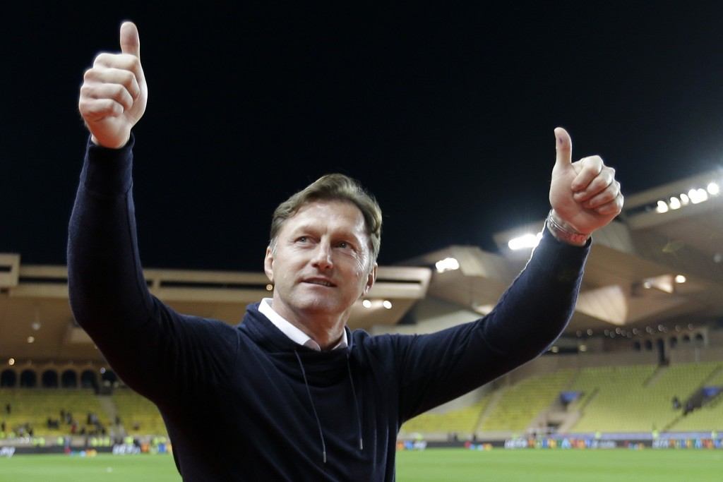 FILE - In this Tuesday Nov. 21, 2017 file photo, Leipzig's head coach Ralph Hasenhuettl gestures to supporters after the Champions League Group G socc