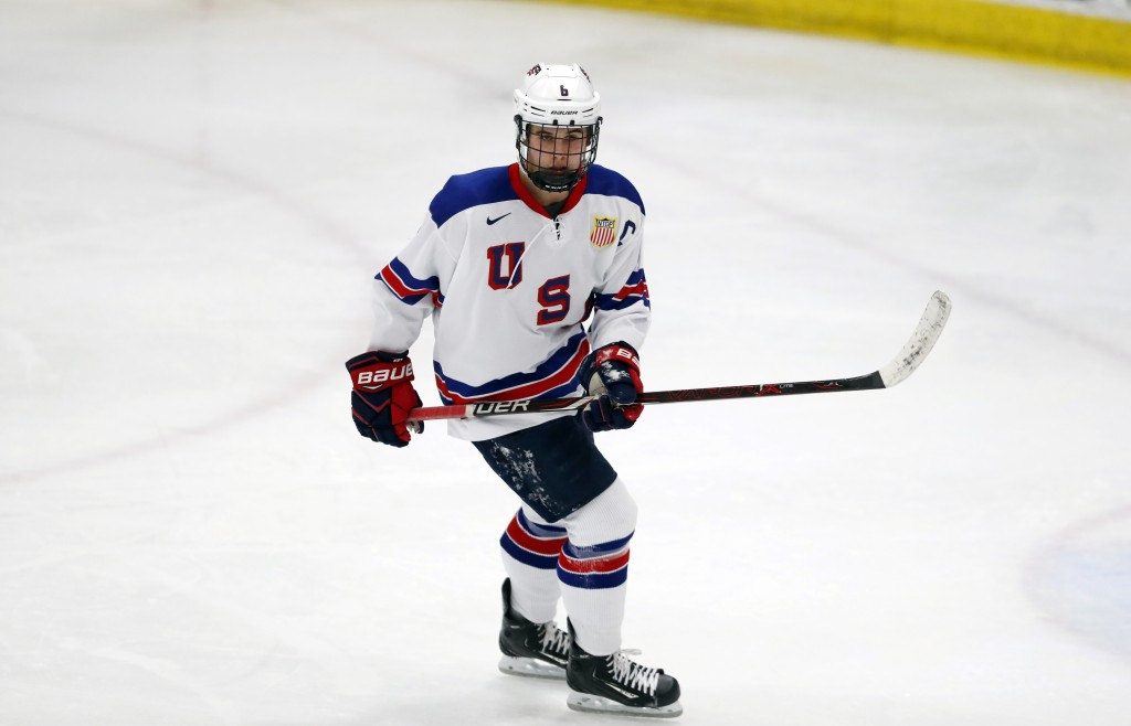 In this Wednesday, Nov. 21, 2018, photo, Jack Hughes, expected to be a top pick in the next NHL hockey draft, plays against Bowling Green in Plymouth,