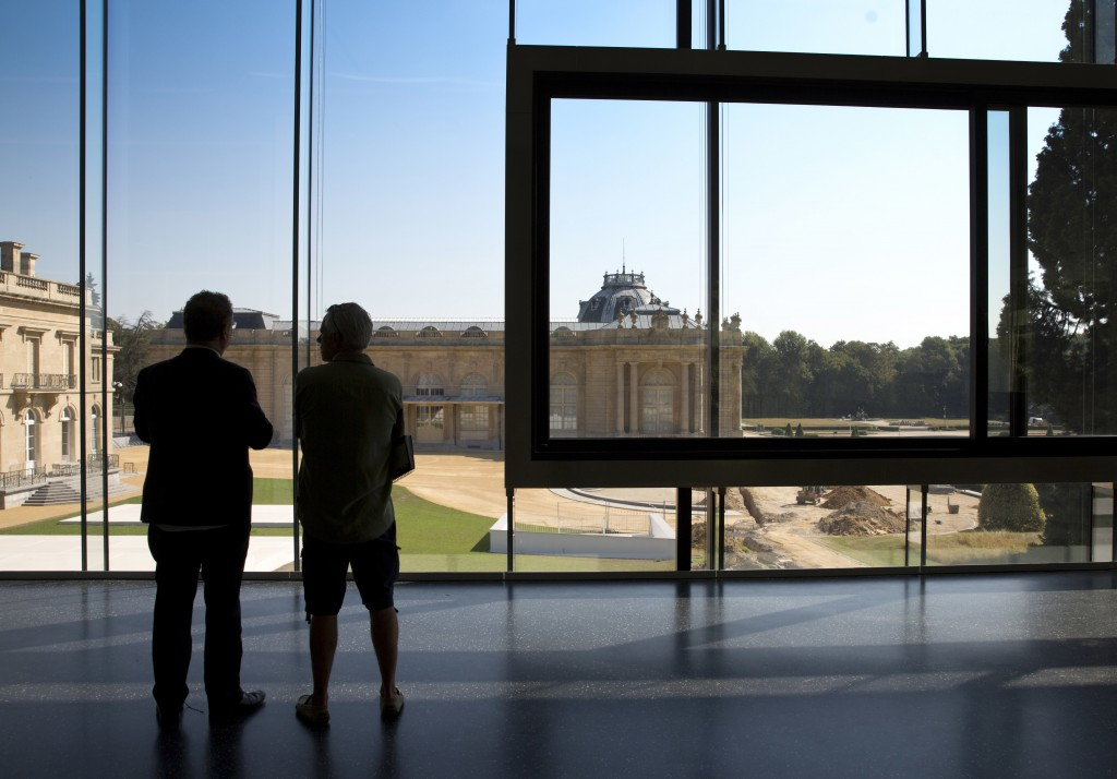 Museum director Guido Gryseels, left, looks out from the new visitor center onto the original Africa Museum in Tervuren, Belgium, Friday, Aug. 3, 2018