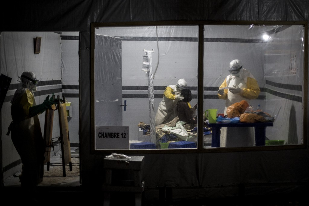 In this photo taken Saturday, Nov. 3, 2018 and made available Tuesday, Dec. 4, 2018, health workers are seen treating an unconfirmed Ebola patient ins