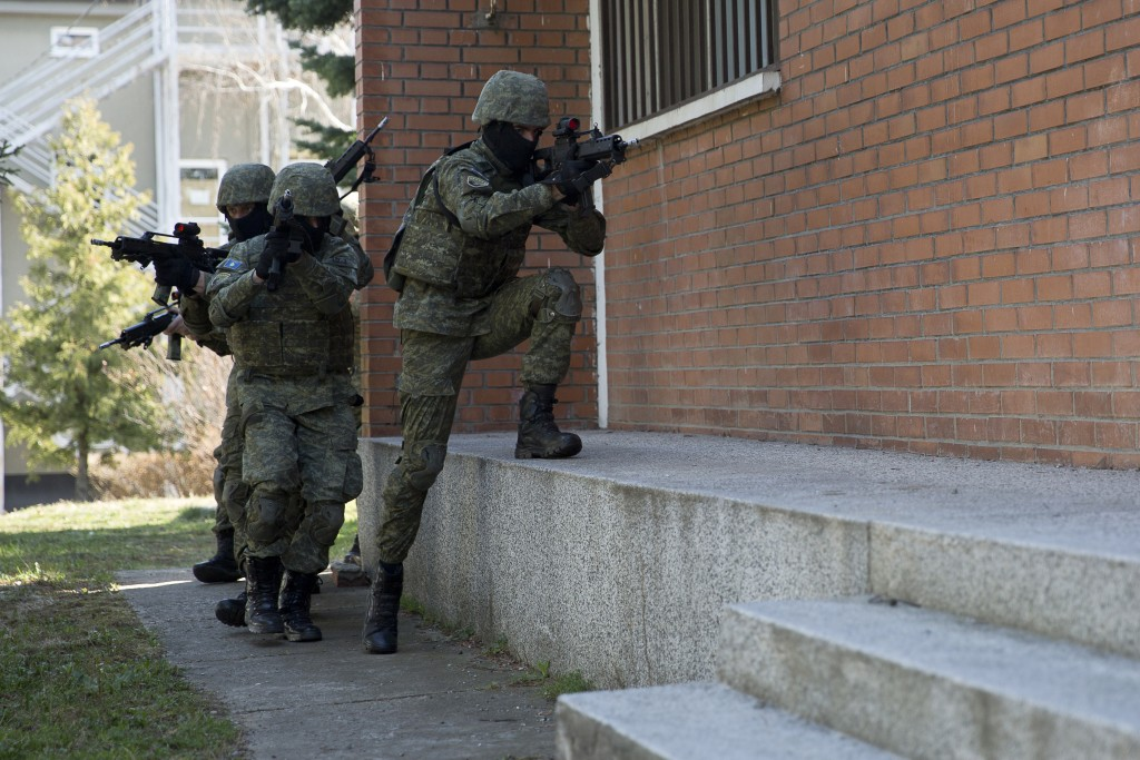 In this photo taken March 22, 2018, members of Kosovo Security Force (KSF) train in hostage rescue situation inside the barracks in the southern part