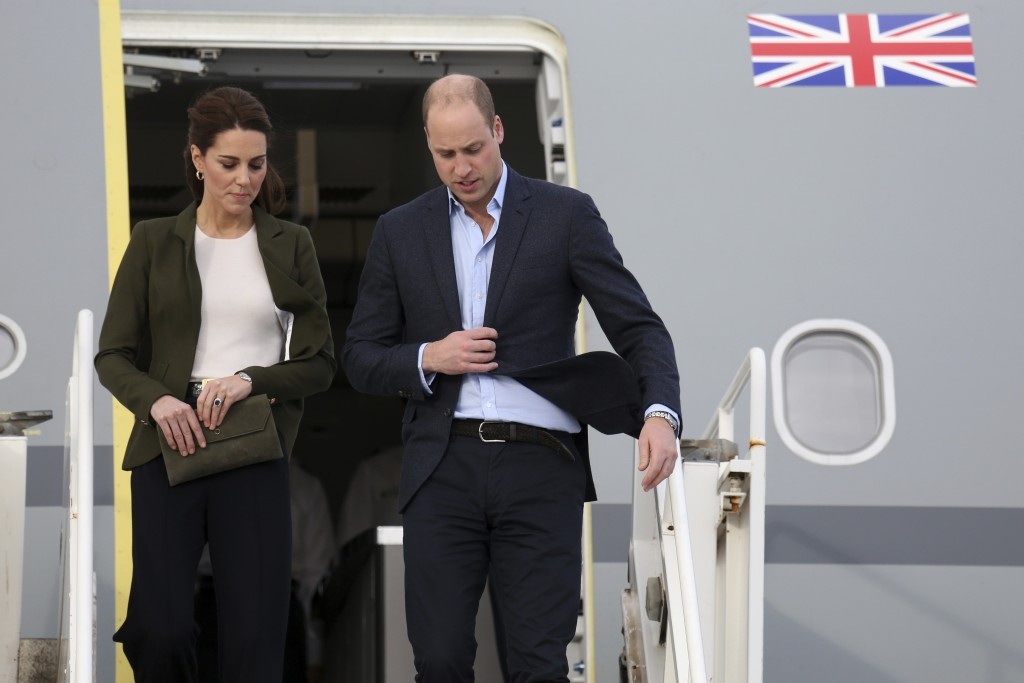 Britain's Prince William right and his wife Kate the Duchess of Cambridge arrive at the Akrotiri Royal Air Force base near the south coastal city