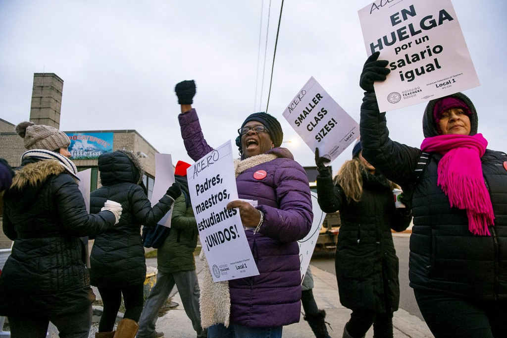 Educators with Acero charter schools strike outside the Veterans Memorial Charter School Campus, Tuesday, Dec. 4, 2018, in Chicago. Hundreds of teache