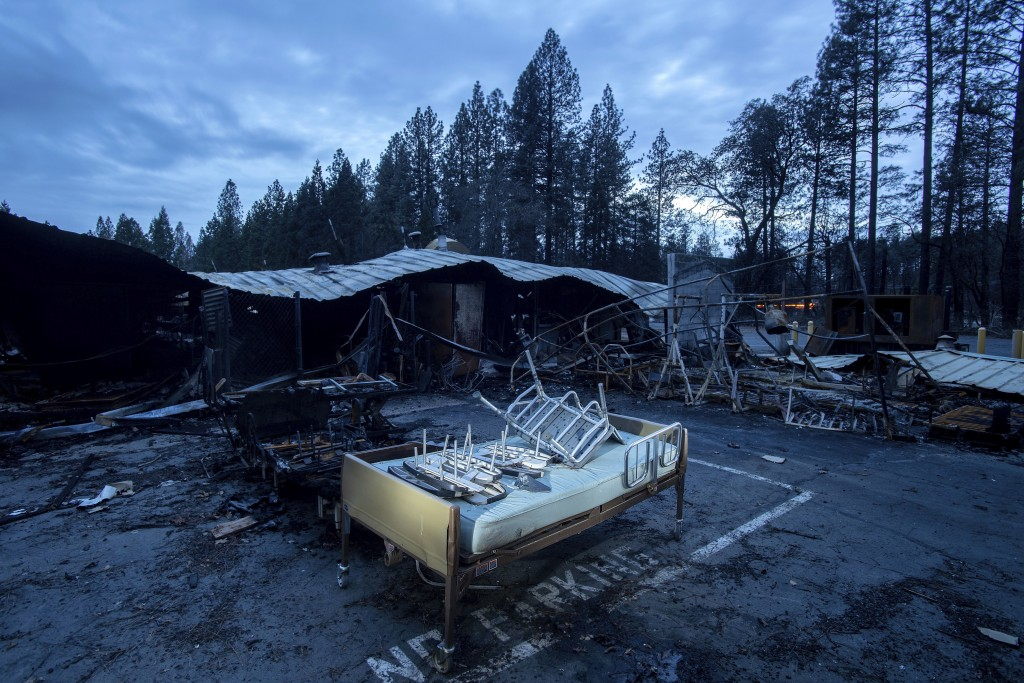 A bed rests outside Cypress Meadows Post-Acute, a nursing home leveled by the Camp Fire, on Tuesday, Dec. 4, 2018, in Paradise, Calif. (AP Photo/Noah