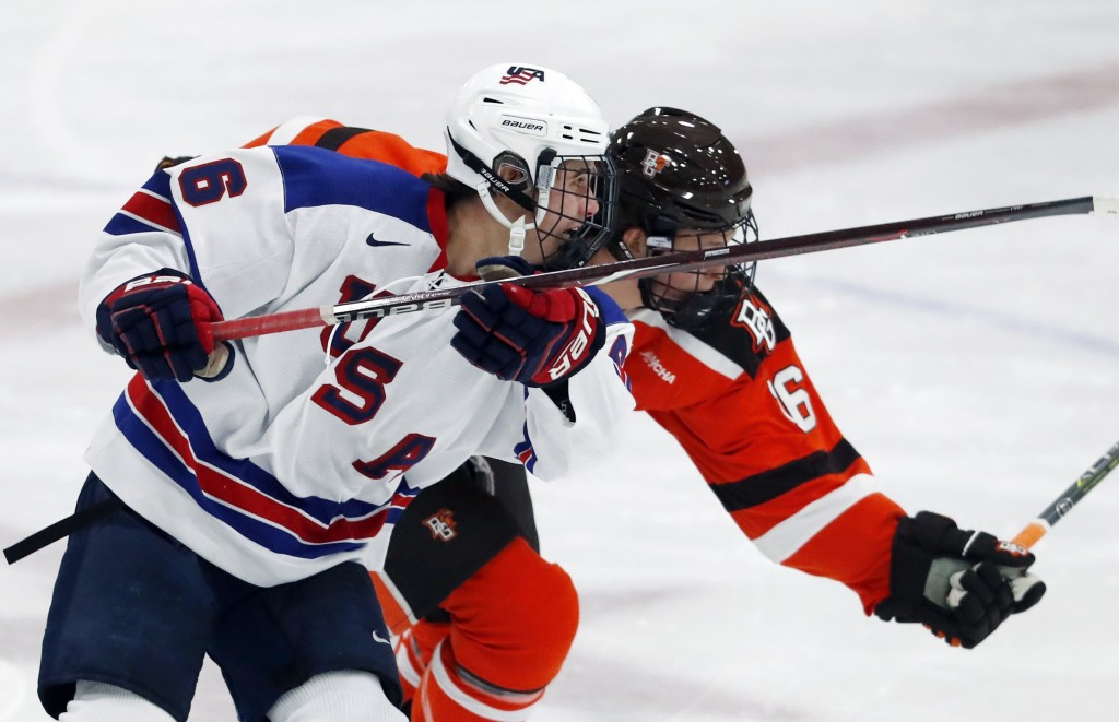 In this Wednesday, Nov. 21, 2018, photo, Jack Hughes, left, expected to be a top pick in the next NHL hockey draft, plays against Bowling Green in Ply...