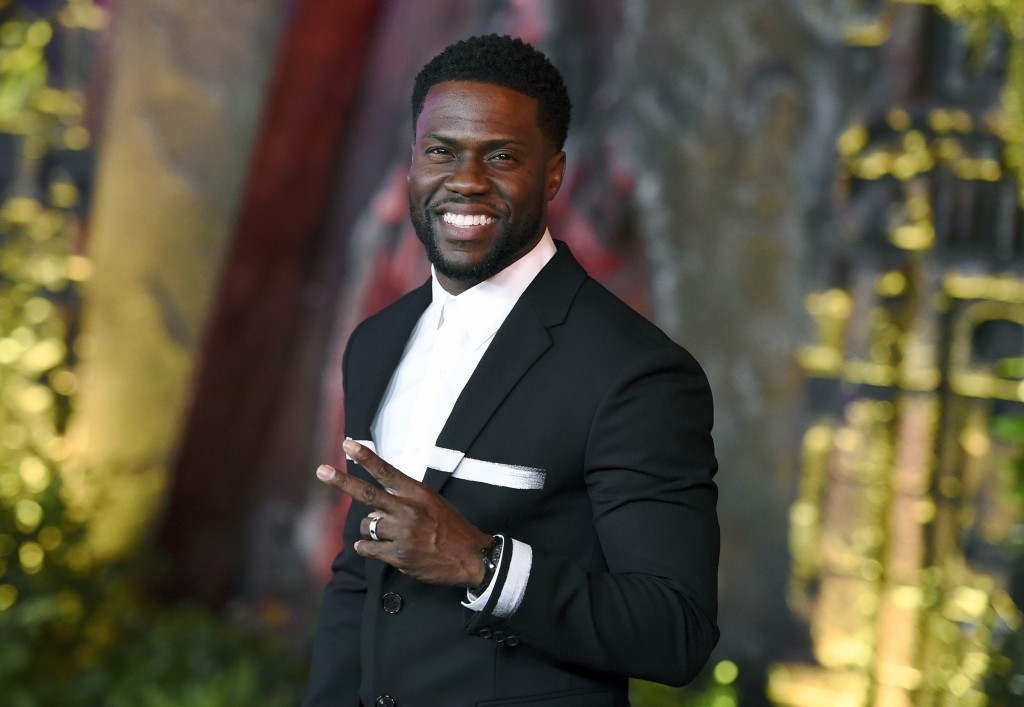 "FILE - In this Dec. 11, 2017 file photo, Kevin Hart arrives at the Los Angeles premiere of ""Jumanji: Welcome to the Jungle"" in Los Angeles. Hart will"