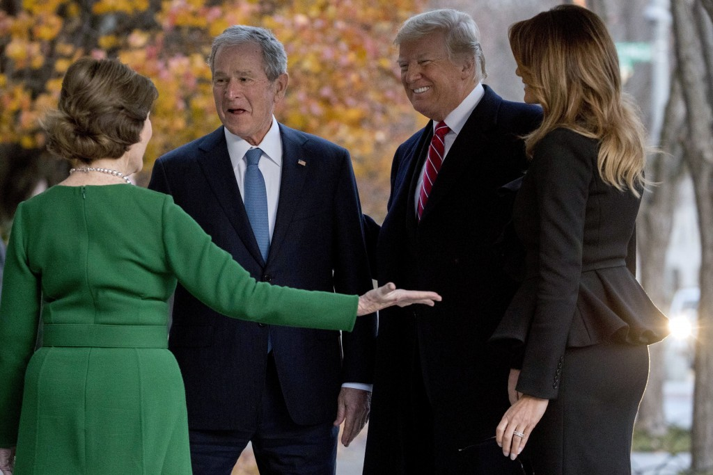 President Donald Trump, second from right, and first lady Melania Trump, right, are greeted by former President George Bush and former first lady Laur