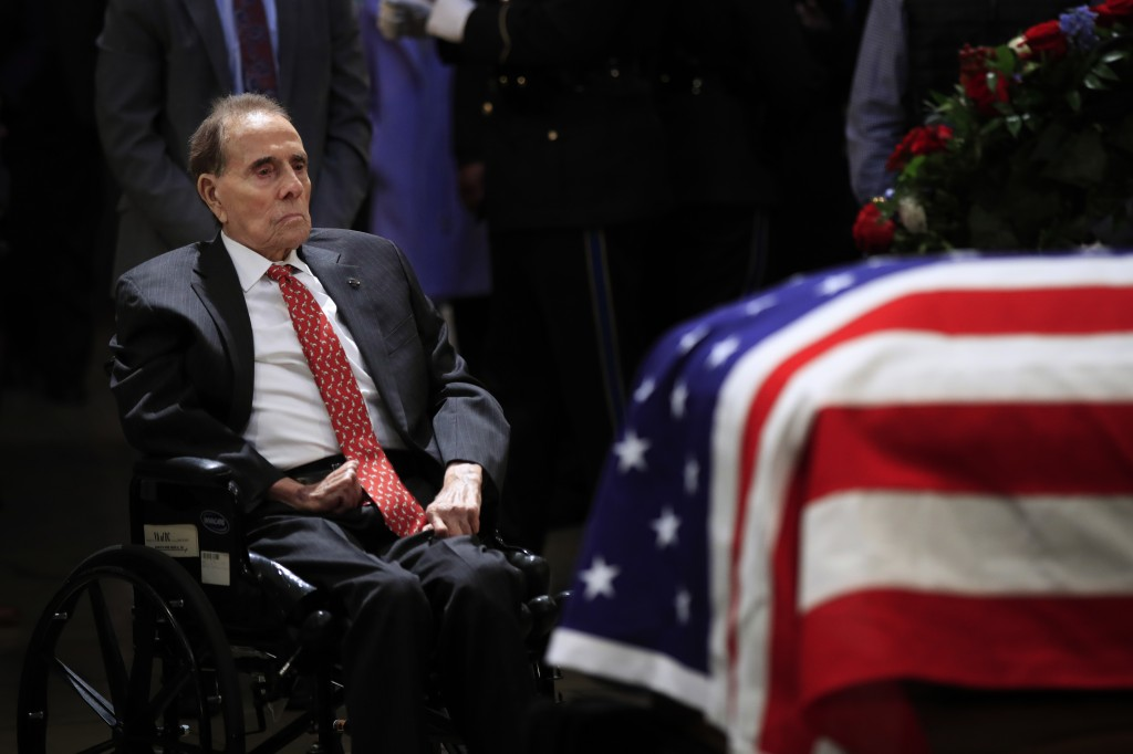 Former Sen. Bob Dole pays his last respects to former President George H.W. Bush as he lies in state at the U.S. Capitol in Washington, Tuesday, Dec.