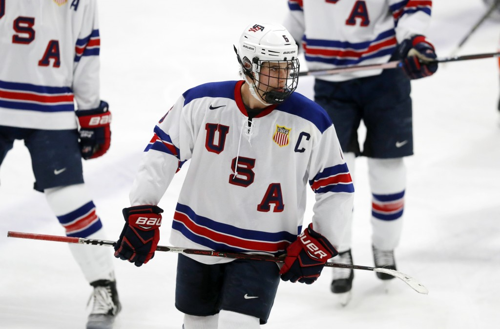 In this Wednesday, Nov. 21, 2018, photo, Jack Hughes, expected to be a top pick in the next NHL hockey draft, plays against Bowling Green in Plymouth,...