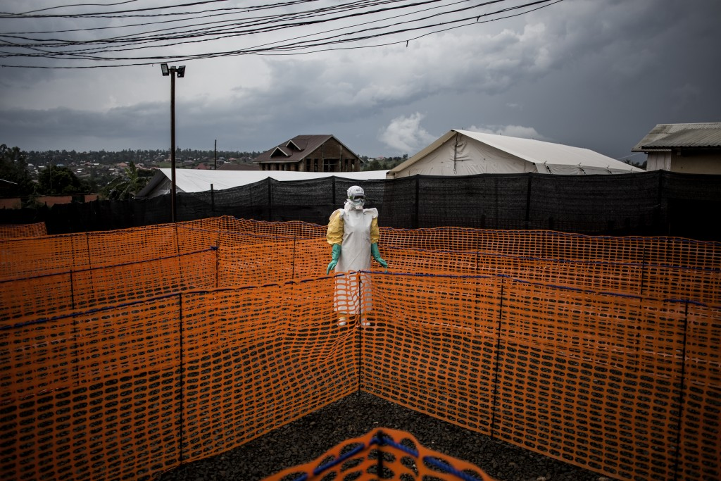 In this photo taken Wednesday, Nov. 7, 2018 and made available Tuesday, Dec. 4, 2018, a health worker waits to receive a new unconfirmed Ebola patient