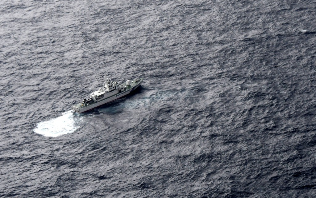 In this aerial photo, Japan's Coast Guard ship is seen at sea during a search operation for U.S. Marine refueling plane and fighter jet off Muroto, Ko