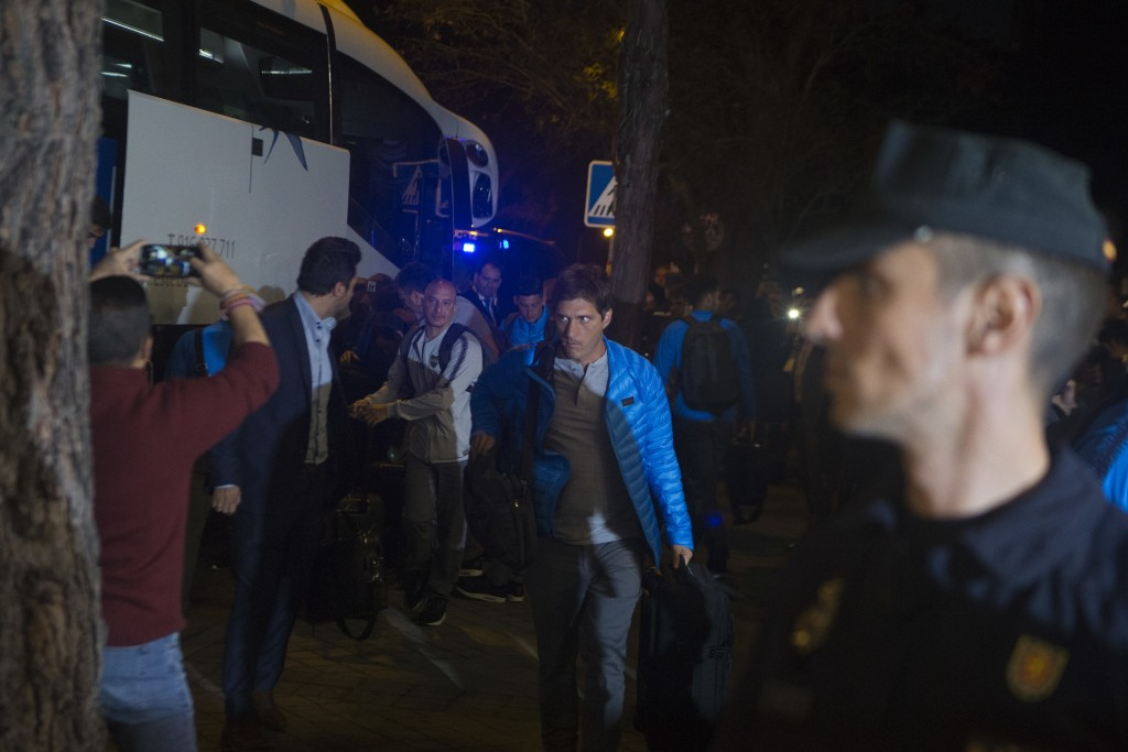 Boca Junior's coach Guillermo Barros Schelotto, center, arrives with his team to their hotel in Madrid, Spain, Wednesday, Dec. 5, 2018. The Copa Liber