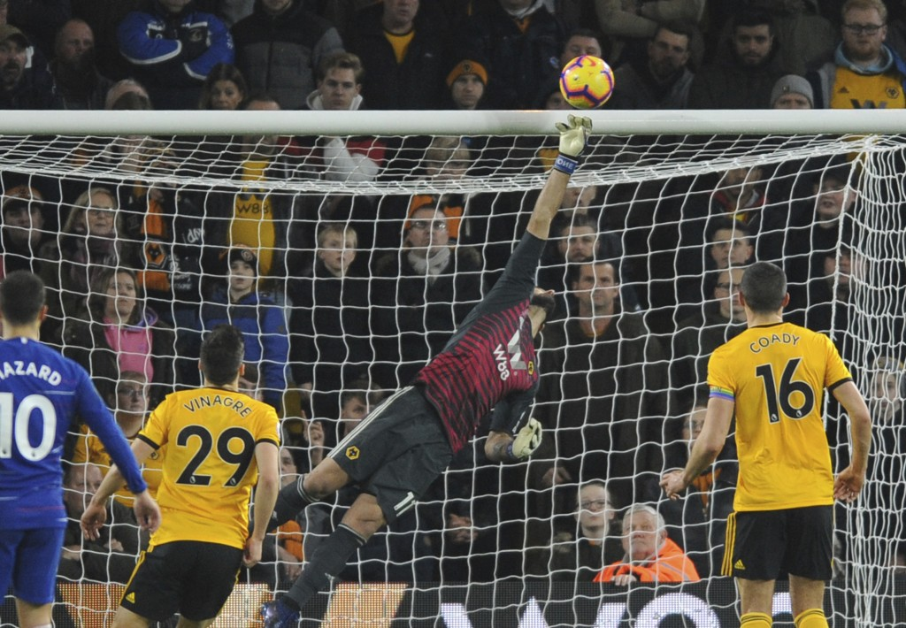Wolverhampton's goalkeeper Rui Patricio makes a save during the English Premier League soccer match between Wolverhampton Wanderers and Chelsea at the
