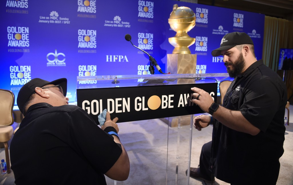 John Langhammer, left, and Brian Cooper, of Crews Unlimited II, set up the podium prior to the announcements of the nominations for the 76th Annual Go