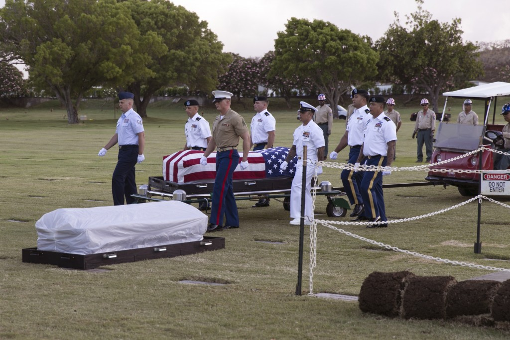 FILE - In this July 27, 2015 file photo, military pallbearers escort the exhumed remains of unidentified crew members of the USS Oklahoma killed in th