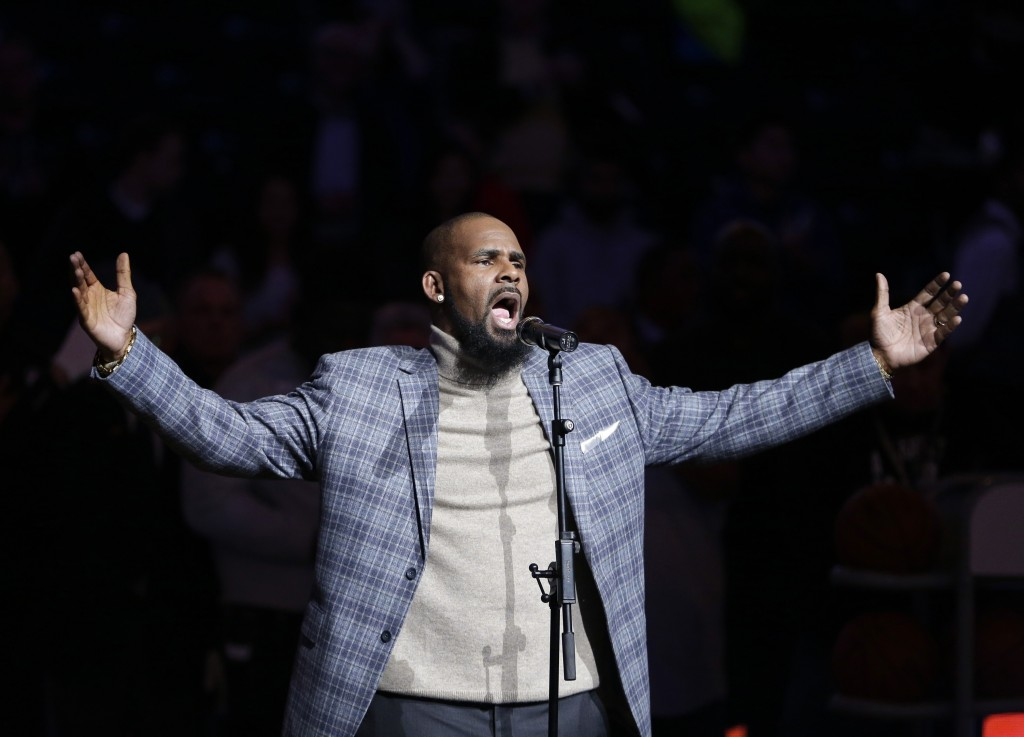 FILE - In this Nov. 17, 2015, file photo, musical artist R. Kelly performs the national anthem before an NBA basketball game between the Brooklyn Nets