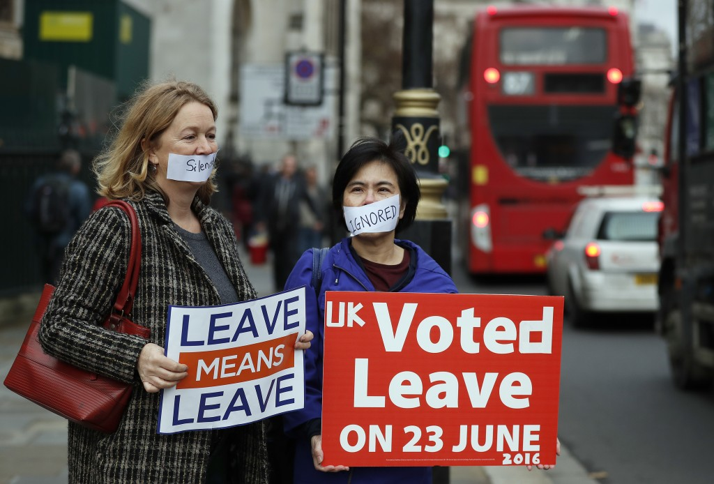 Demonstrators protest for Brexit outside the Houses of Parliament in London Thursday Dec. 6, 2018.  Britain's Prime Minister Theresa May's effort to w