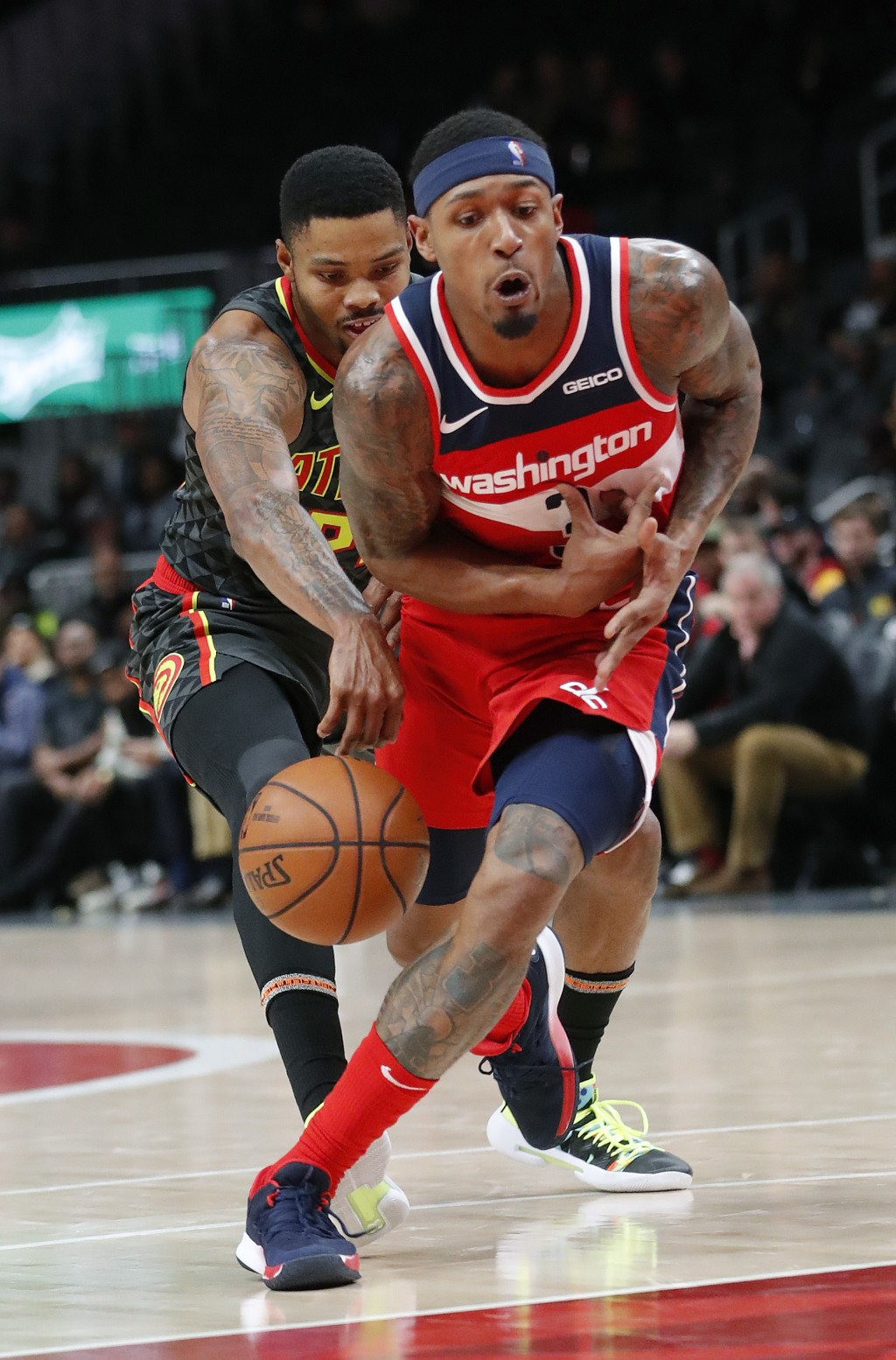 Washington Wizards guard Bradley Beal (3) is fouled by Atlanta Hawks guard Kent Bazemore (24) as he drives to the basket during the second half of an
