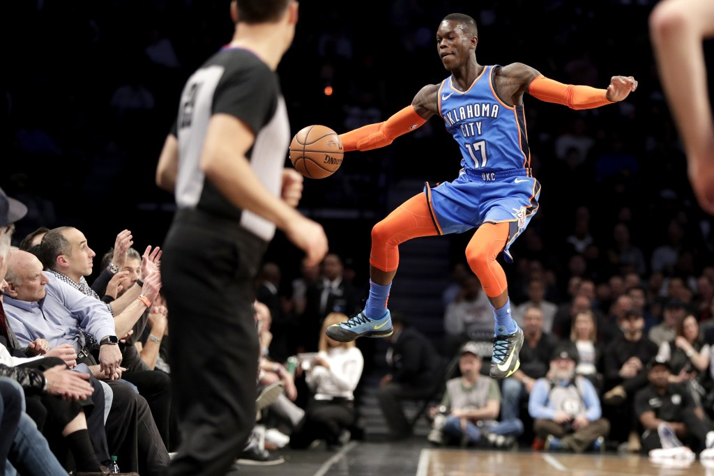 Oklahoma City Thunder guard Dennis Schroder fails to keep the ball in bounds during the first half of an NBA basketball game against the Brooklyn Nets