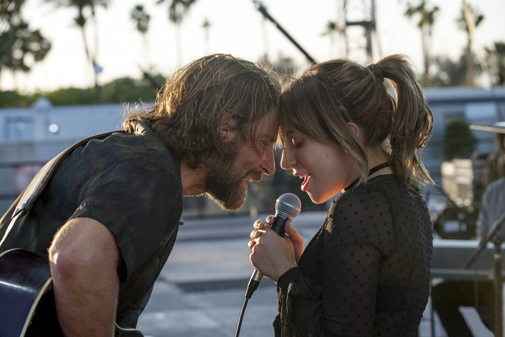 "This image released by Warner Bros. shows Bradley Cooper, left, and Lady Gaga in a scene from the latest reboot of the film, ""A Star is Born."" On Thur"