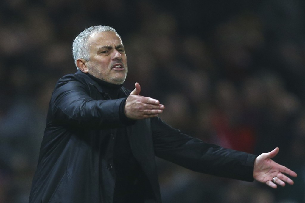 Manchester United's coach Jose Mourinho gives directions to his players during the English Premier League soccer match between Manchester United and A
